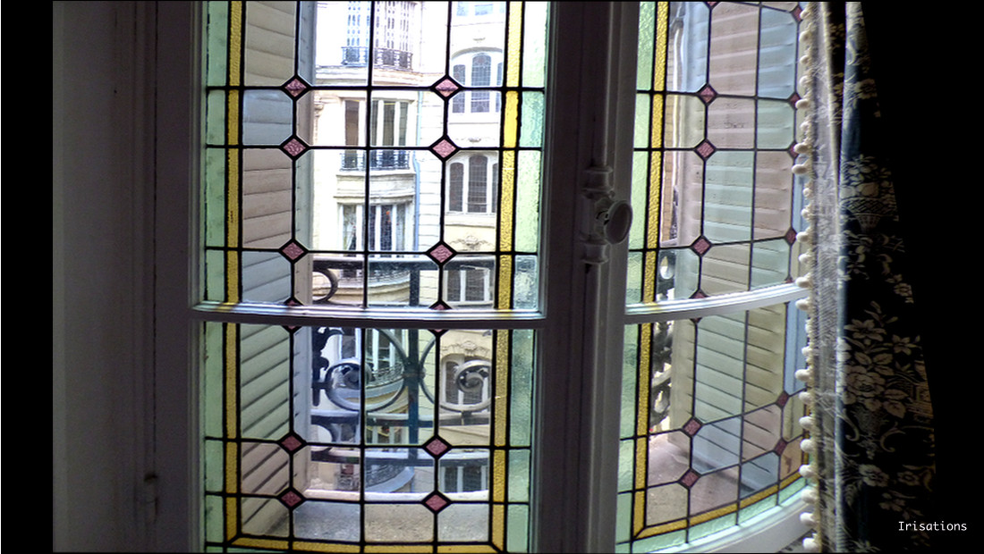 restoration geometric stained glass window haussmann apartment flat paris
